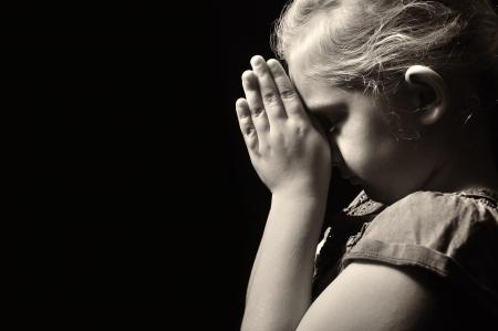 Praying child  Standard-Bild