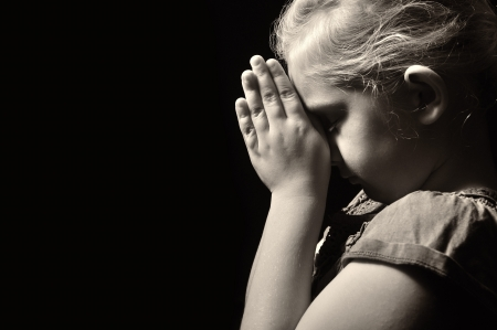 sad child: Praying child  Stock Photo