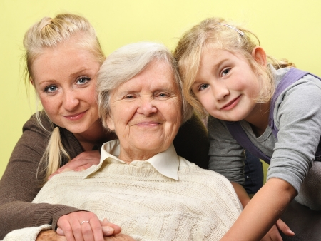 kin: Three women - three generations  Happy and smiling  Stock Photo