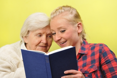 senior reading: Senior woman with her caregiver in home