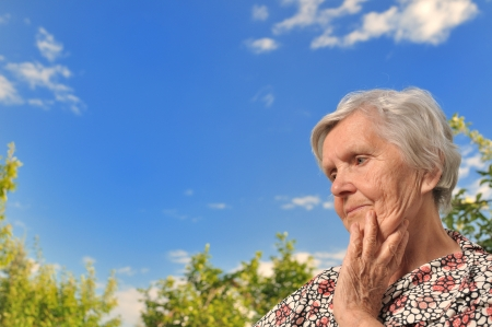 Senior woman - thinking, outdoors
