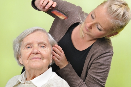 disabled person: Senior woman with her caregiver in home