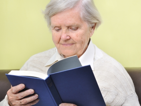 Senior woman reading book in home  Stock Photo - 16035205