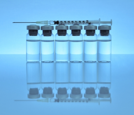 injected: Vials of medications with syringe and needle