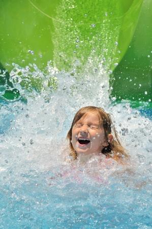 Happy girl in water
