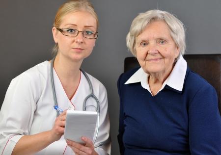 高齢者の女性と若い医者 写真素材