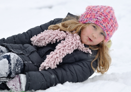 life jacket: Young girl in a winter scene