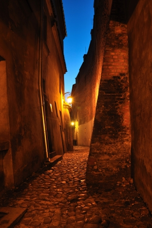 Old, stone street with lantern at dusk  Lublin in Poland  photo