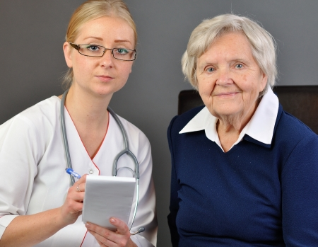 Elderly woman and a young doctor  photo