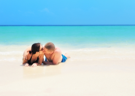 Kissing couple on the beach  photo
