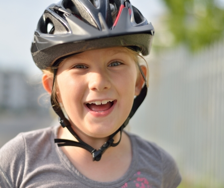 Young girl in a bicycle helmet  photo