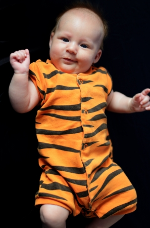 rompers: Baby like tiger  Stock Photo