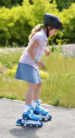 Young girl riding on roller skates  photo