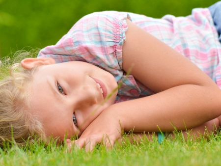 Young girl lying on the grass  photo