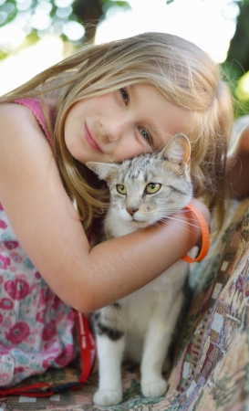 Little girl with cat  Outdoors  photo