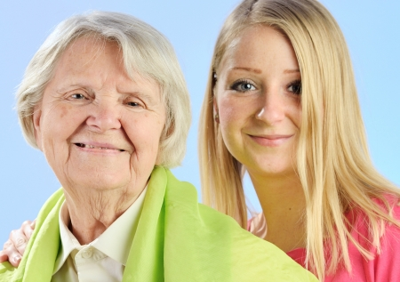 Child and grandchild give a gift their grandmother, expressing his care and love for her  photo