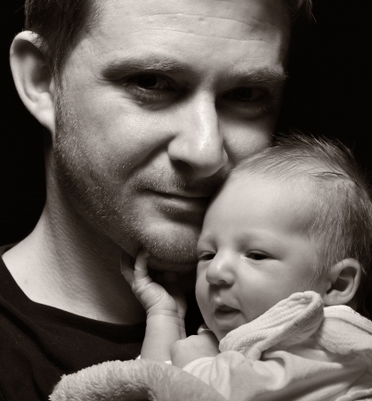 Father and his newborn baby  photo