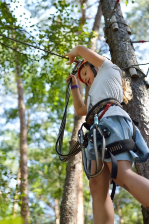 Little girl climbing up the ropes  Stock Photo