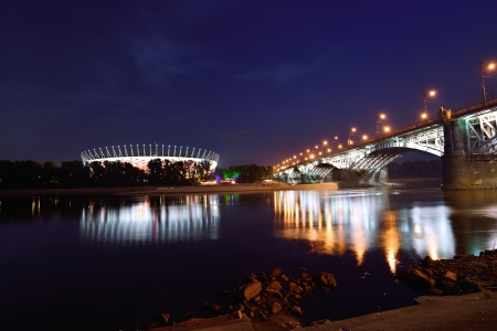 polska: Poniatowski Bridge and National Stadium in Warsaw by night  Editorial