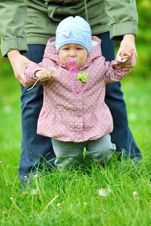 Baby learns to walk in the grass  photo