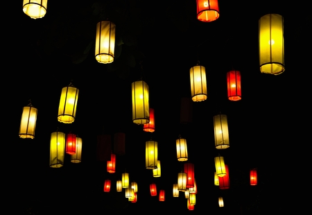 Many lanterns against the black sky photo