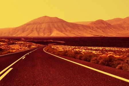 Road on Lanzarote - sunset  Stock Photo