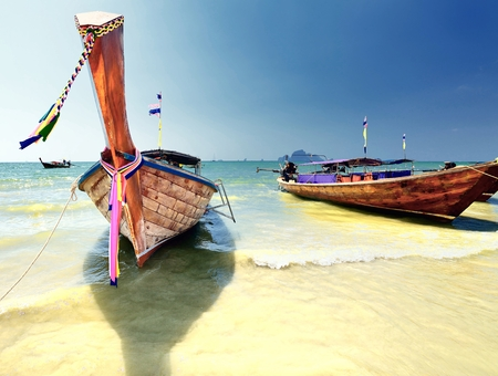 Longtail boat on ropical beach in Krabi, Andaman Sea, Thailand  photo