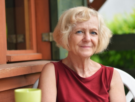 mid adults: Mature, blonde woman in garden, Stock Photo