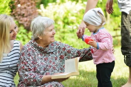 Grandmother and granddaughter  Happy and smilling family  Standard-Bild