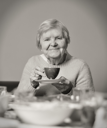 Senior smiling woman drinking tea  photo