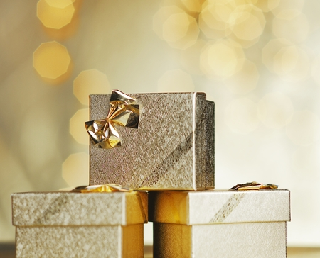 three gift boxes: Golden gifts.