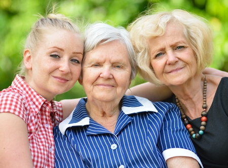 three generations: Happy and smilling family. Three generations of women. Stock Photo
