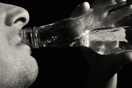 habituation: Man drinks vodka. Alcoholic. Stock Photo