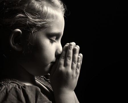 Praying child.