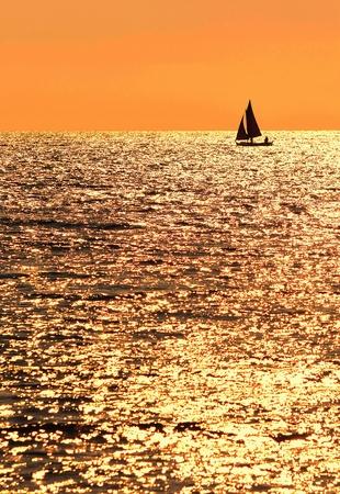 Sailing at sunset photo