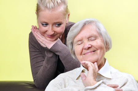 adore: Senior woman with her caregiver.  Happy and smiling. Stock Photo