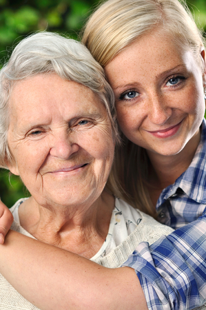 granddaughter: Grandmother and granddaughter. Young woman takes care of an elderly woman.