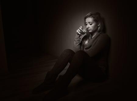 drinking problem: Sad woman.