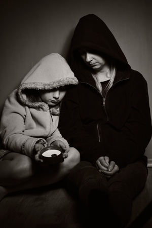 Homeless mother with her daughter. Poor family. photo