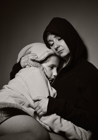 poor children: Homeless mother with her daughter. Poor family. Stock Photo