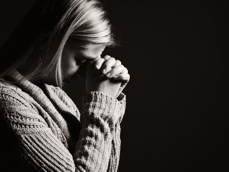 Praying woman. Archivio Fotografico