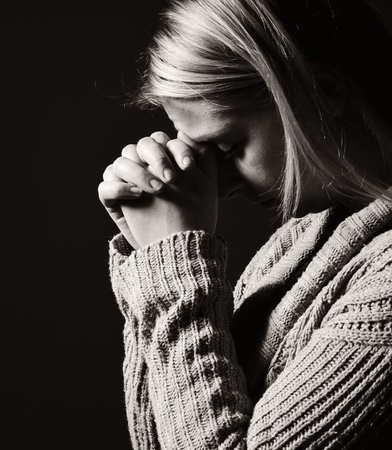 hands clasped: Praying woman. Stock Photo