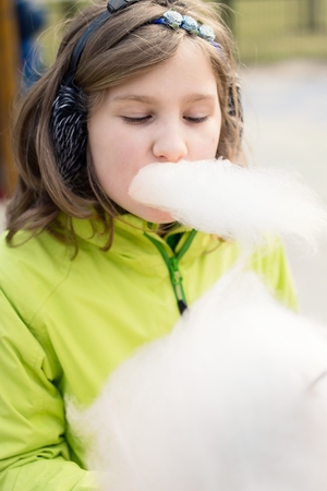 Young girl eating candyfloss. photo