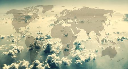 hemisphere: World map on the background of sky with clouds.