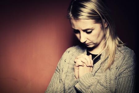woman praying: Praying woman. Stock Photo