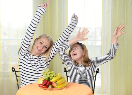 dancing house: Mother and daughter are playing together. Happy and smiling family.