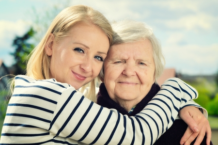 friend hug: Grandmother and granddaughter. Happy family. Stock Photo
