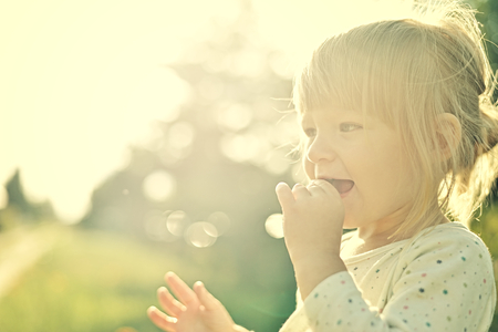 back lighting: Cute little girl in the sunshine. Back lighting.