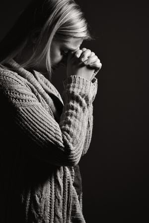 repentance: Praying woman. Stock Photo