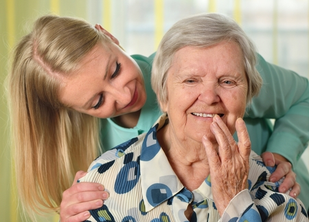 happy senior: Senior woman with her caregiver. Happy and smiling. Stock Photo